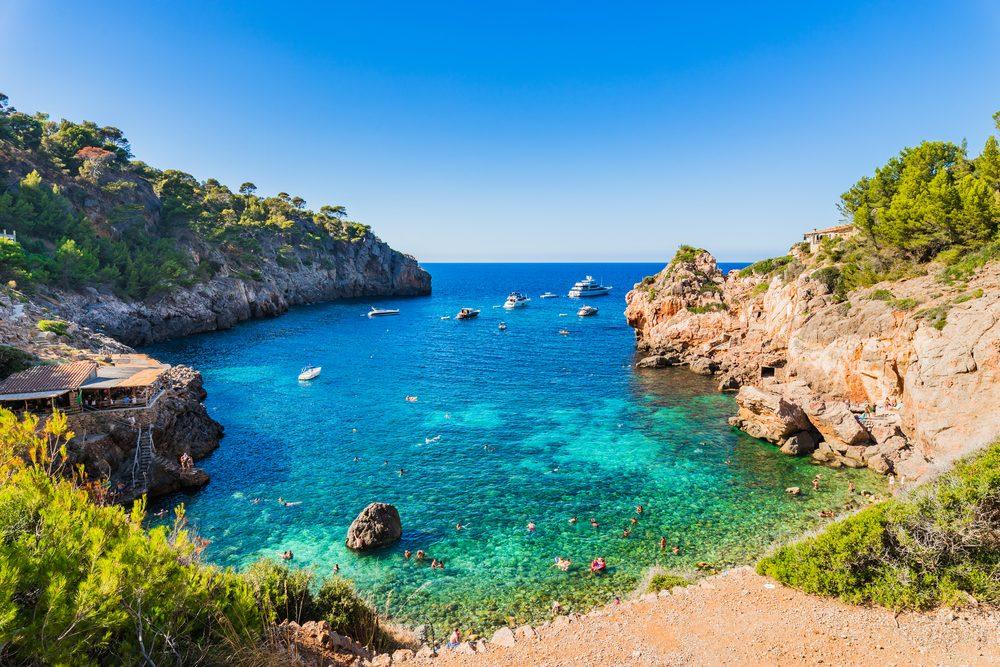 Idyllic seascape of the beautiful bay beach of Cala Deia, Majorca island, Mediterranean Sea, Spain Balearic islands.