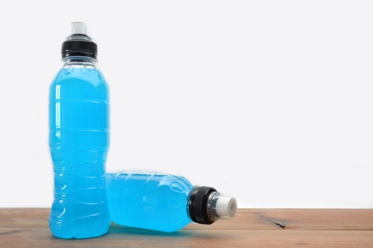 sports drink on wooden table and white background