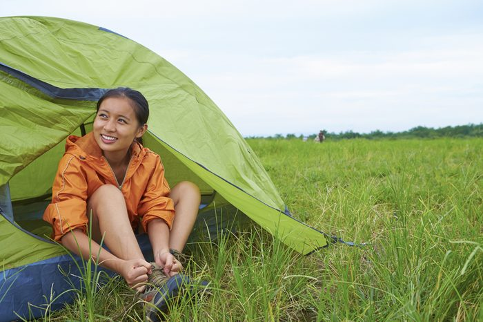 One Young Chinese Backpacker Camping Outdoor in the Nature at Summer time