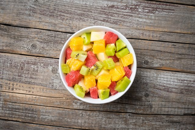 Fresh fruit salad on an old wooden background