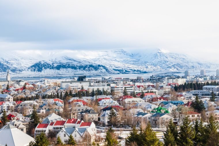 Beautiful view of Reykjavik winter in Iceland winter season with snow-capped mountain in the background, Reykjavik is the capital city of Iceland.