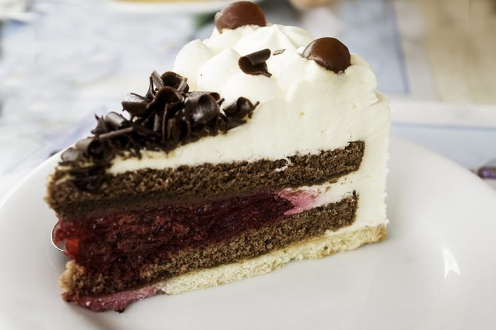 Chocolate and raspberry cake with cranberries, dessert in restaurant