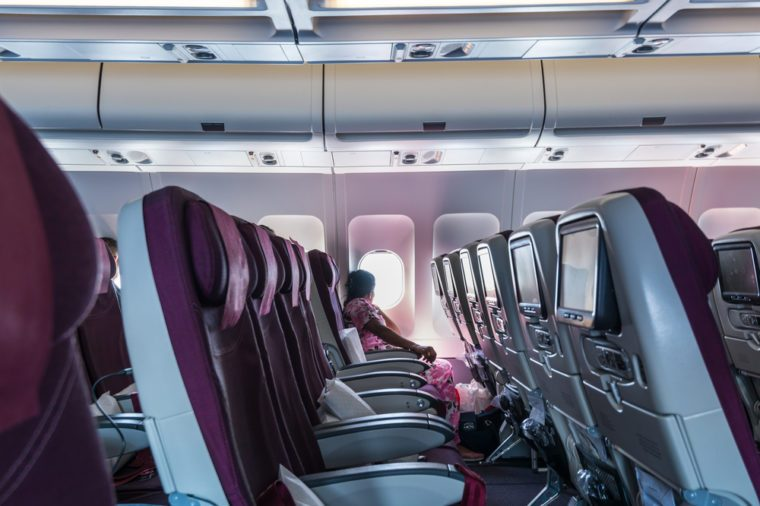 Beirut, Lebanon, May 2nd, 2017, An Indian woman looking at the window of airplane of Qatar Airways in the blue sky flying to Doha