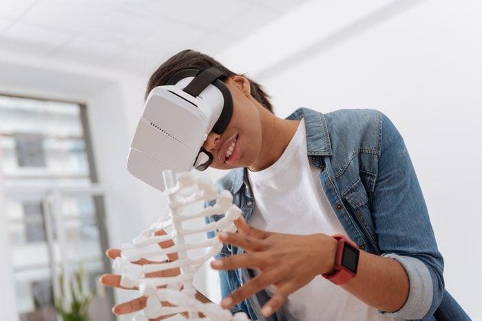 Joyful curious woman using 3d technology