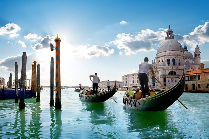 Ride on gondolas along the Gand Canal in Venice, Italy.