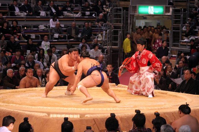 FUKUOKA, JAPAN - NOVEMBER 19: Unidentified Sumo wrestlers ready to engage in the arena of the Fukuoka Tournament on November 19, 2010 in Fukuoka, Japan.