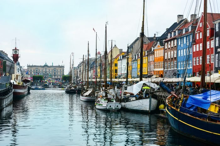 Copenhagen Nyhavn (New Harbour), in Copenhagen, Denmark. New port of Copenhagen. Colorful old town architecture. Copenhagen style, European street