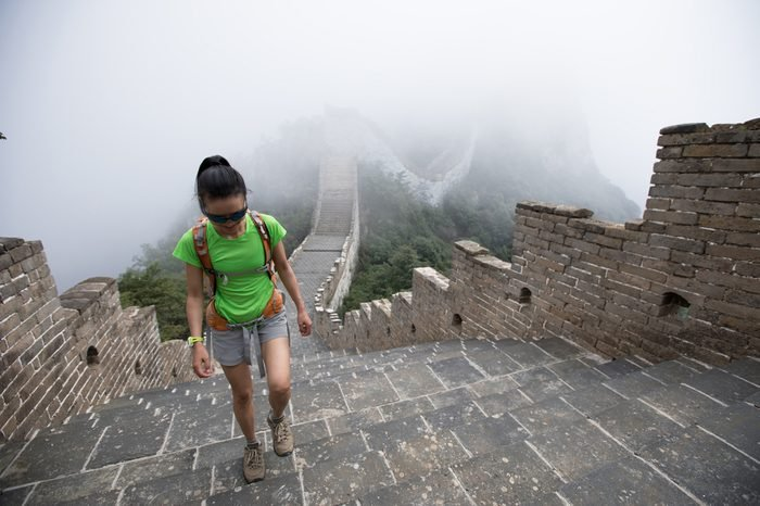 young woman hiker hiking on great wall