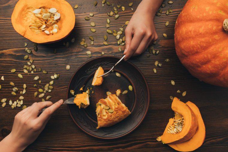 top view of women eating pumpkin pie