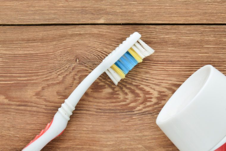 Toothbrush and toothpaste on a wooden table. The beauty and health of your teeth. The concept of dental care.