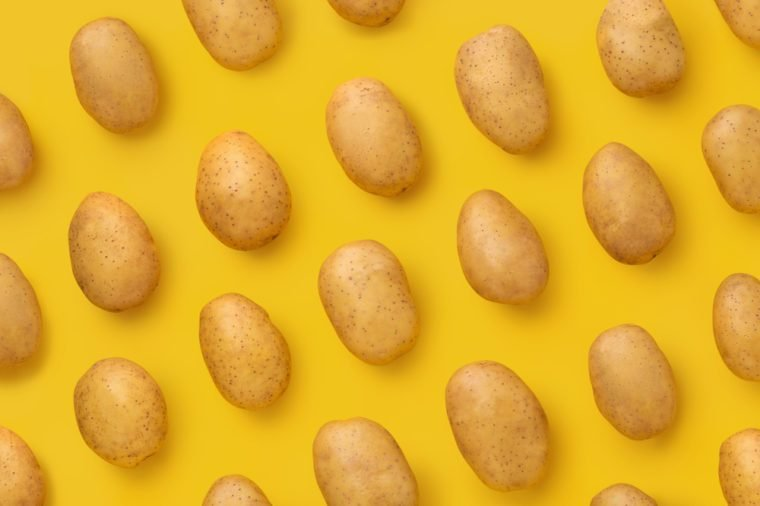 Potato on a colored background. Pattern of potato. Natural potato