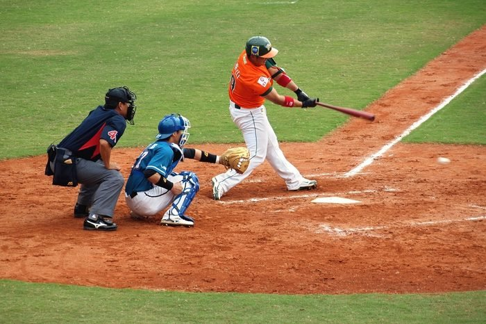 PINGTUNG, TAIWAN, APRIL 8: Batter Zhang of the President Lions hits the ball in a game of the China Pro Baseball League against the Lamigo Monkeys. The Lions won 2:0 on April 8, 2012 in Pingtung.