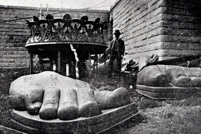 The feet of the Statue of Liberty arrive on Liberty Island 1885. The statue was a gift from the people of France to the United States, It represents Libertas, the Roman goddess of freedom.