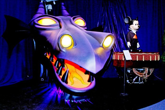 """The dragon head """"Maleficent"""" from the """"Fantasmic!"""" show on Tom Sawyer's Island at Disneyland Park from 1992 is displayed next to an audio-animatronic figure of Mickey Mouse from Fantasyland in 1971 during a preview of """"D23 Presents Treasures Of The Walt Disney Archives,"""" at the Ronald Reagan Presidential Library & Museum in Simi Valley, Calif., . D23, the official Walt Disney fan club, refers to 1923, the year Disney founded his world-famous company. The exhibit features more than 500 historic artifacts, including models, props, artwork and set pieces, many never before seen by the public, from nearly nine decades of Disney history. The exhibit opens to the public on July 6"""