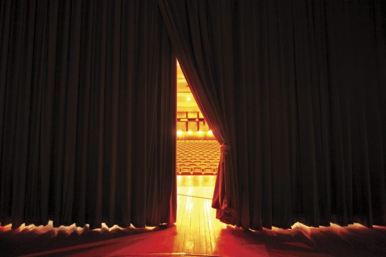 Theater seats through curtains.. behind scene