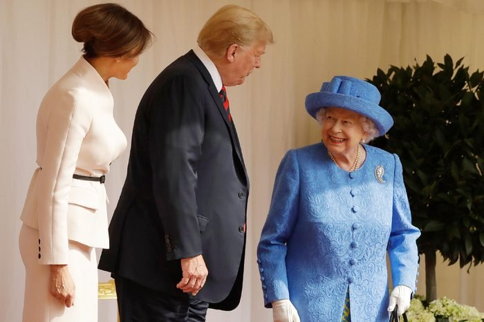 U.S. President Donald Trump and first lady Melania Trump speak with Britain's Queen Elizabeth II on the dais in the Quadrangle of Windsor Castle in Windsor, England