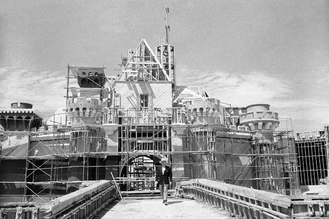 Walt Disney crosses the drawbridge that serves as the entrance to the castle in what will be the heart of Disneyland, in California on April 16, 1955. It's located at the end of Main Street and will house part of Fantasyland. This is the castle where you can see the dining hall awaiting the returning King Arthur's Knights, Sleeping Beauty slumbering, Peter Pan ride, Alice in Wonderland's story and many others. (AP Photo/David F. Smith)