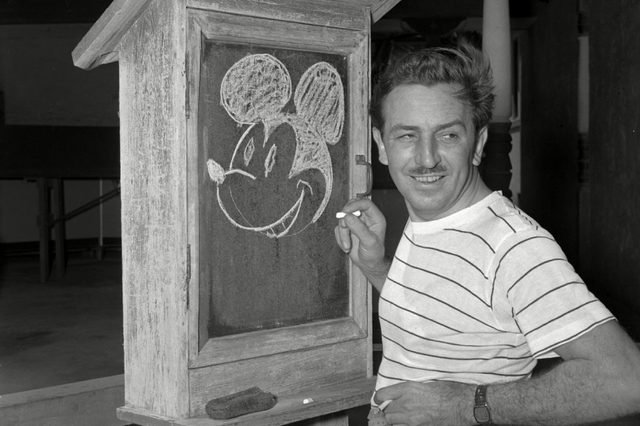 """WALT DISNEY Walt Disney, creator of Mickey Mouse, poses at the Pancoast Hotel in Miami, Fla., on . An animation innovator, Disney featured his favorite character in """"Steamboat Willie,"""" the first short cartoon with a soundtrack, in September 1928. He released his first full-length animated film, """"Snow White and the Seven Dwarfs,"""" in 1937. A multimedia visionary whose name became synonymous with family entertainment, Disney expanded into television and book publishing, and led the way for a new kind of amusement park known as the """"theme park."""" Disney opened Disneyland in California in the 1950s"""