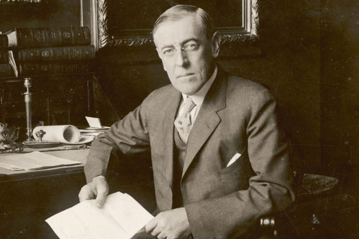 Woodrow Wilson 28th President of of U S Seated at His Desk and Holding A Document 1856 - 1924
