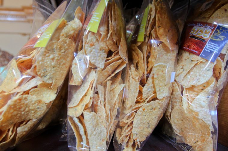 YOGYAKARTA 2013 - Store in Yogyakarta selling keripik tempe or tempe crispy chip in a plastic bag during June holiday season