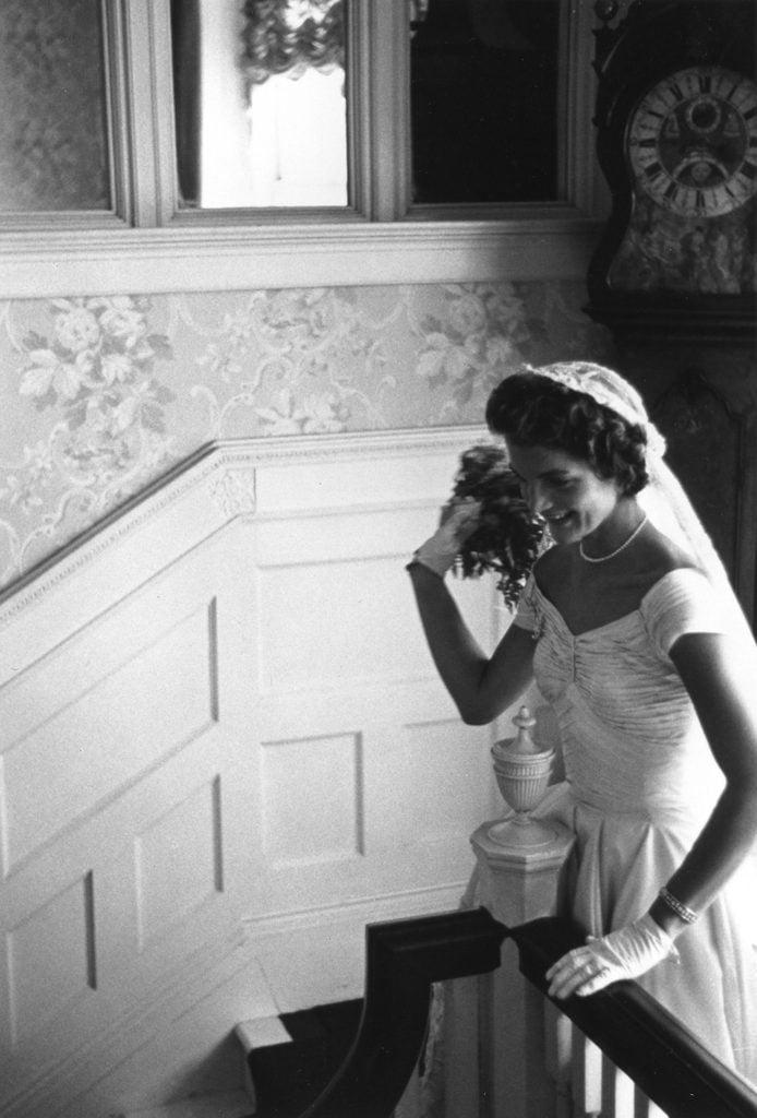 Mrs. Kennedy throws her bouquet