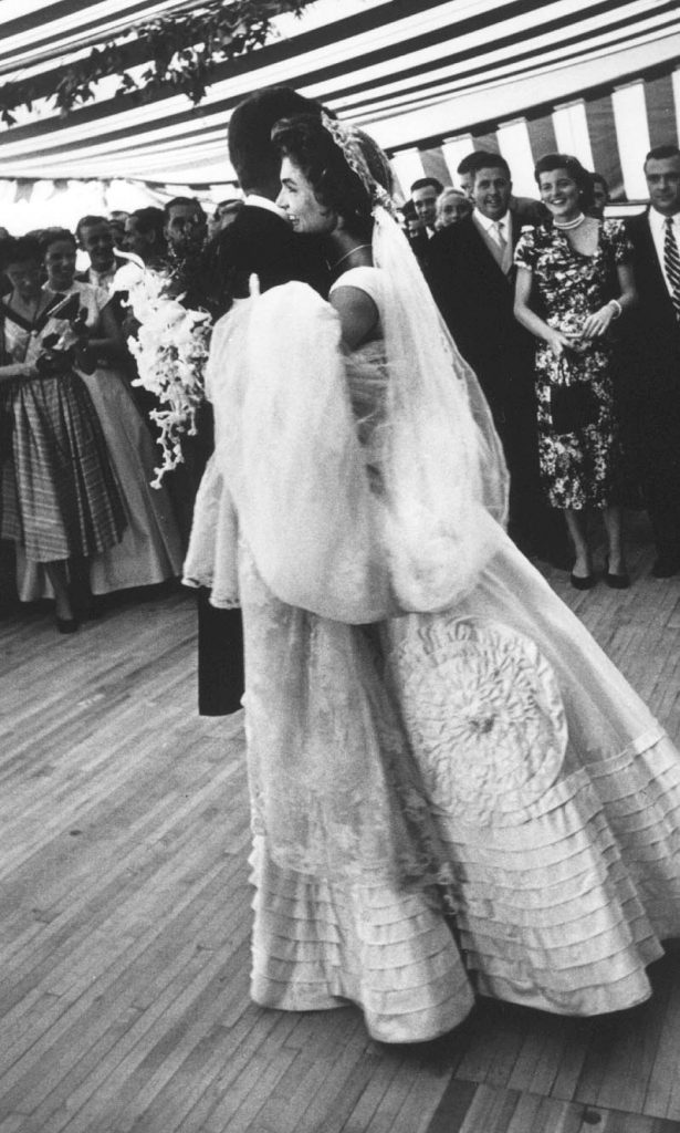 John F. Kennedy and Jacqueline Bouvier dancing at wedding