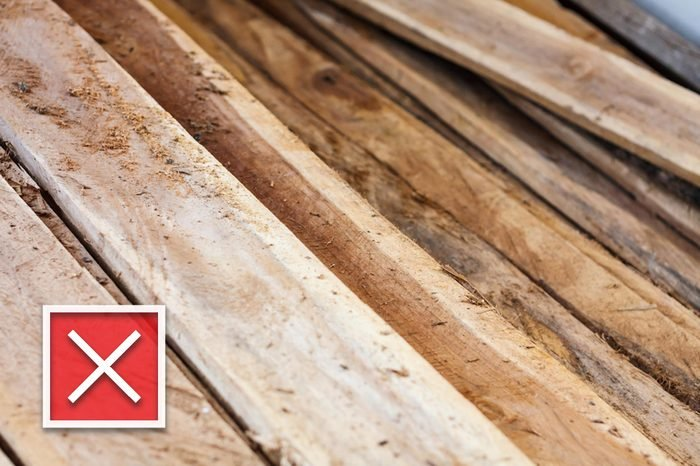 Large stack of wood planks