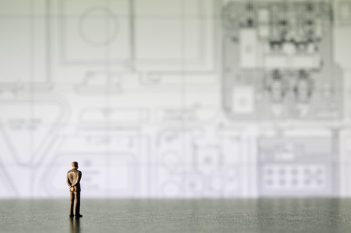 businessman miniature people looking diagram
