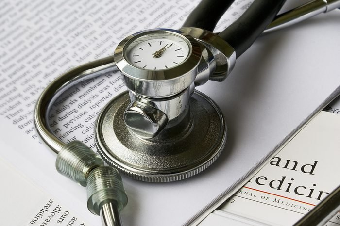 Stethoscope with clock on books