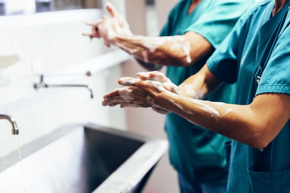 Couple of Surgeons Washing Hands Before Operating. Hospital Concept.