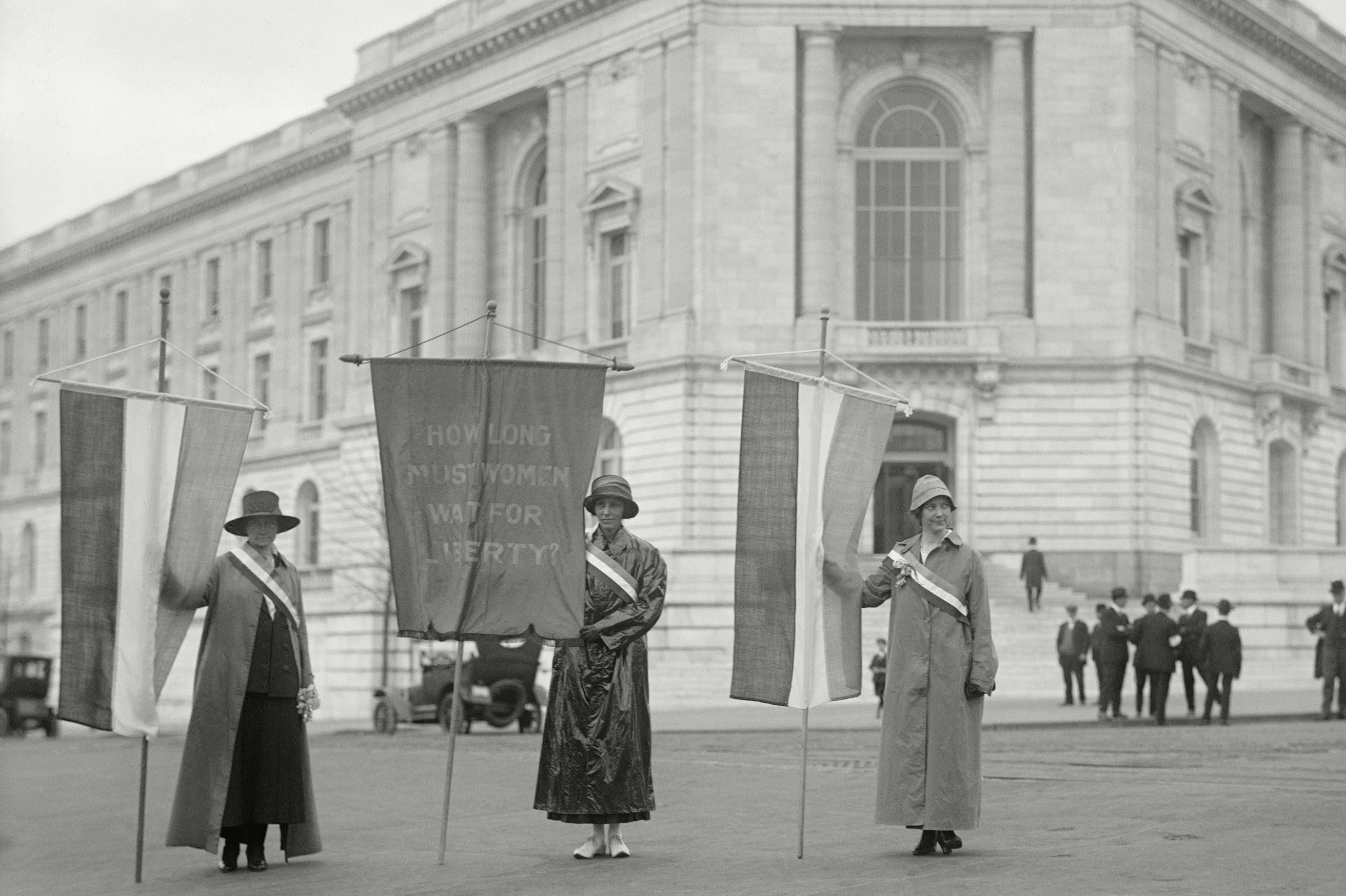 Mandatory Credit: Photo by Everett/Shutterstock (10278080a) Suffragettes picketing the Senate Office Building in Washington in 1918. Left to right: Mildred Gilbert, Pauline Floyd, Vivian Pierce. They display a banner, How Long Must Women Wait for Liberty? Historical Collection