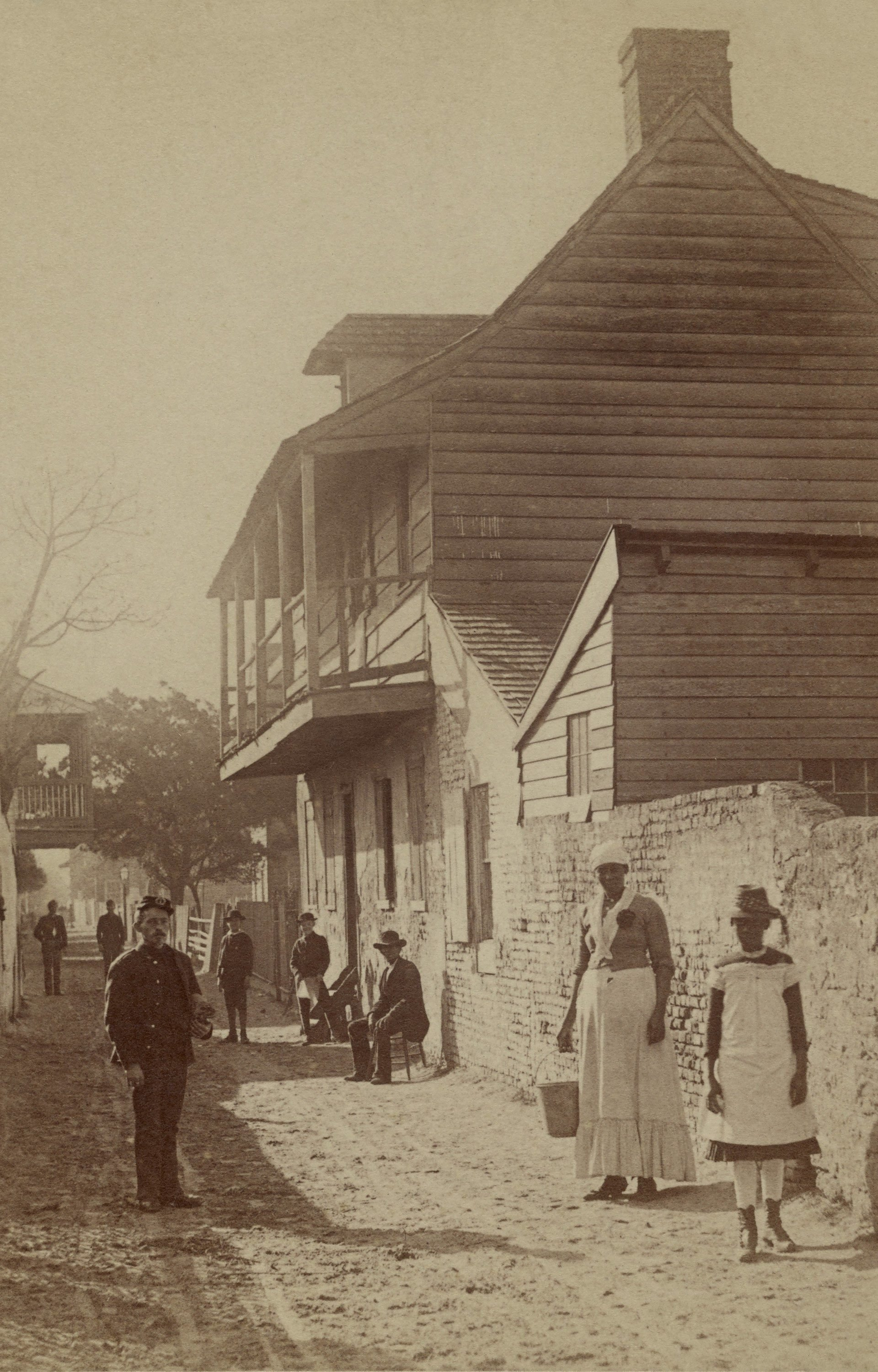 Mandatory Credit: Photo by Everett/Shutterstock (10408919a) Street scene with a soldier, two African American women, and others in St. Augustine, Florida, 1886. Photo by George Barker