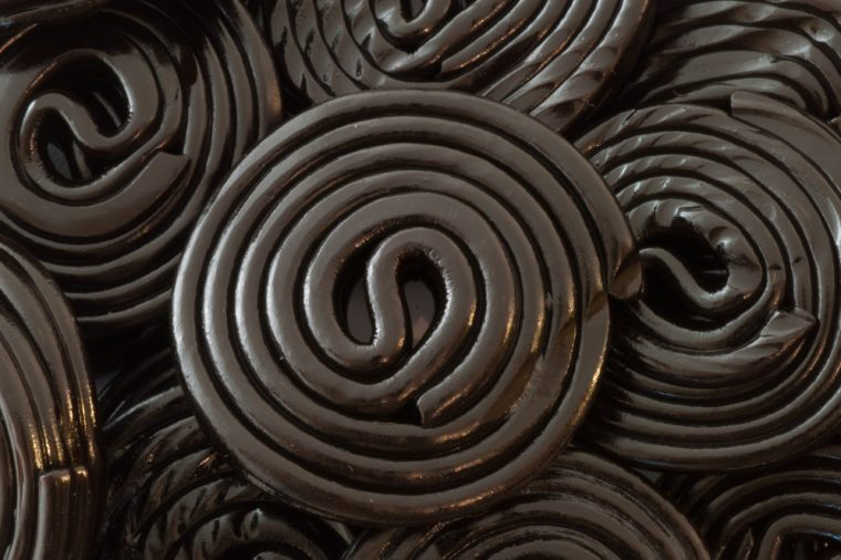 macro background of black spiral licorice in studio
