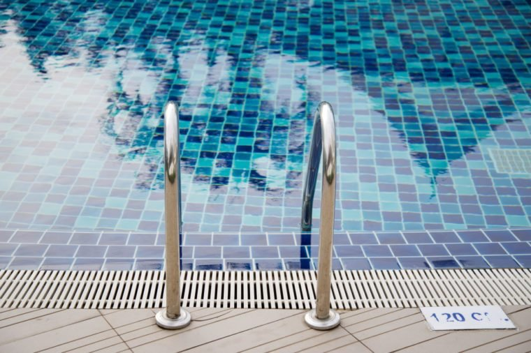 Stainless ladder on the edge of swimming pool