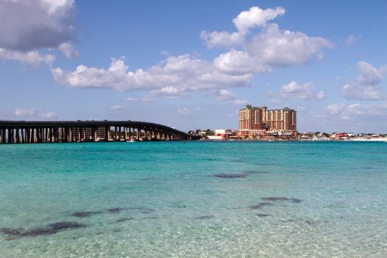 Highway 98 bridge goes across the crystal clear waters of the pass in the resort town of Destin, Florida