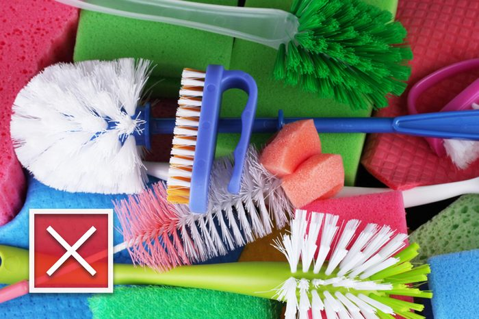 Many colorful sponges and brushes for housework