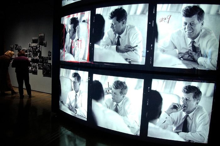 Photos of John F. Kennedy are seen at the Sixth Floor Museum in Dallas, . Hundreds of restored photographs taken by Jacques Lowe are on display beginning Nov. 22. These candid contact-sheet images, many never been seen before, are all that remains of the Lowe collection. More than 40,000 of his negatives of the Kennedy family were destroyed in the 2001 World Trade Center attacks