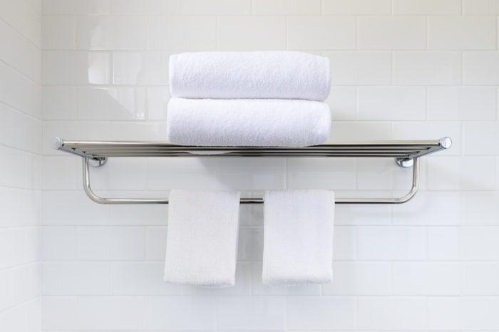 White towel on hanger rack in bathroom