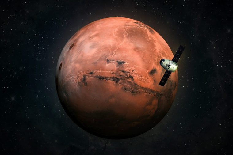 Cargo spaceship in the space and MARS on the background. Astronomy and deep space conception. Colonization of Mars. Elements of this image furnished by NASA