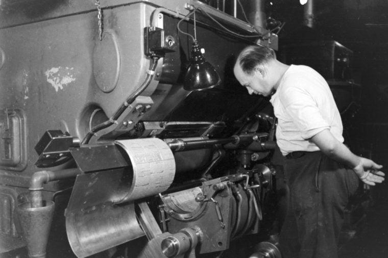 Man inspecting printing press