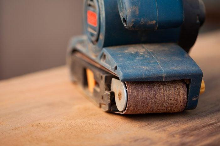 Close up of a belt sander