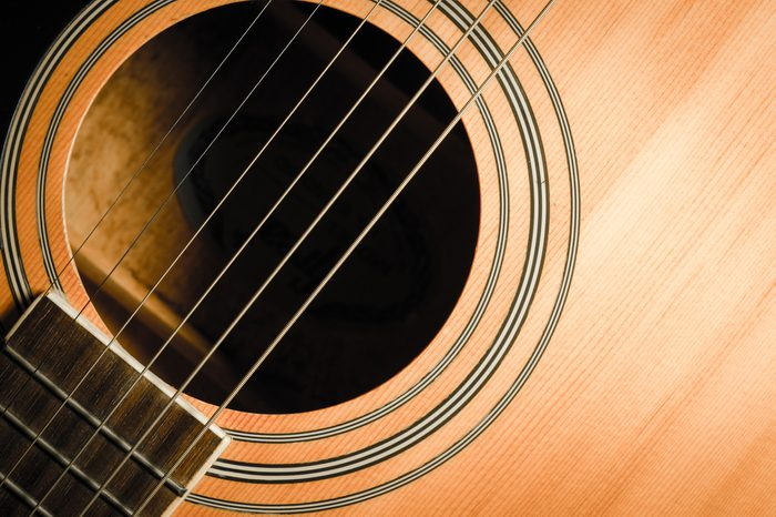 Close-up of brown wooden classical guitar.vintage guitar