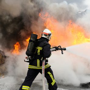 firefighter extinguishes a fire