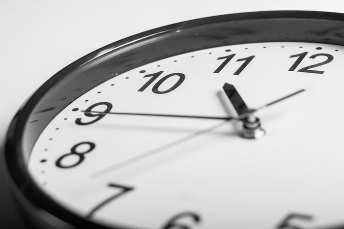 close up a wall clock that 20 min before 11 o'clock