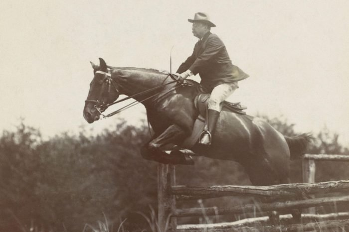President Theodore Roosevelt, on horseback jumping over wood fences at Chevy Chase Club, 1907. Photo by B.F. Clinedinst