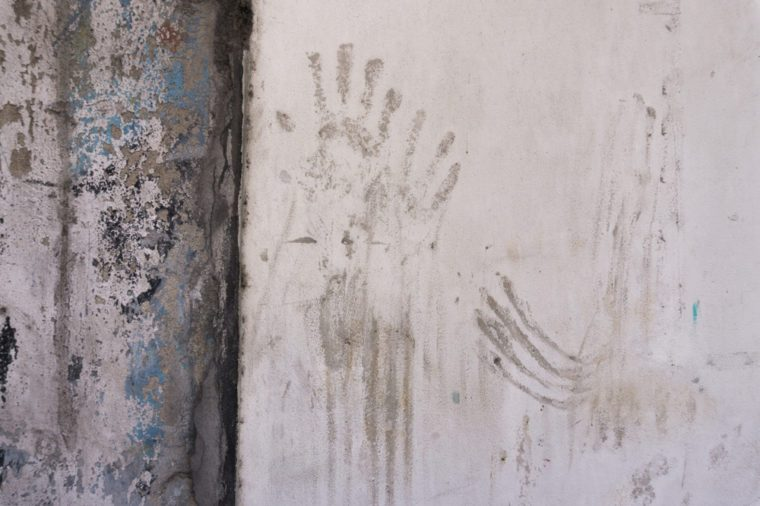 dirty handprints on the wall