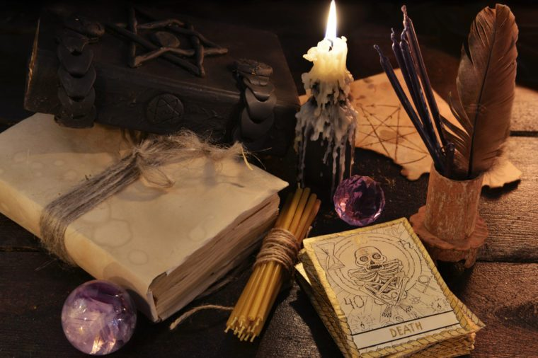 Still life with magic objects, books, candles and the tarot cards. Halloween and magic still life, fortune telling seance or black magic ritual with mysterious occult and esoteric symbols