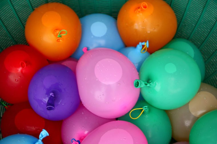 colorful water balloons in the basket prepare for games.