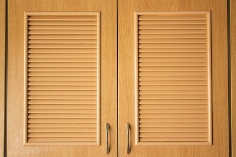 Wooden door of wardrobe in kitchen for being design interior of creative background, with flat pattern in surface