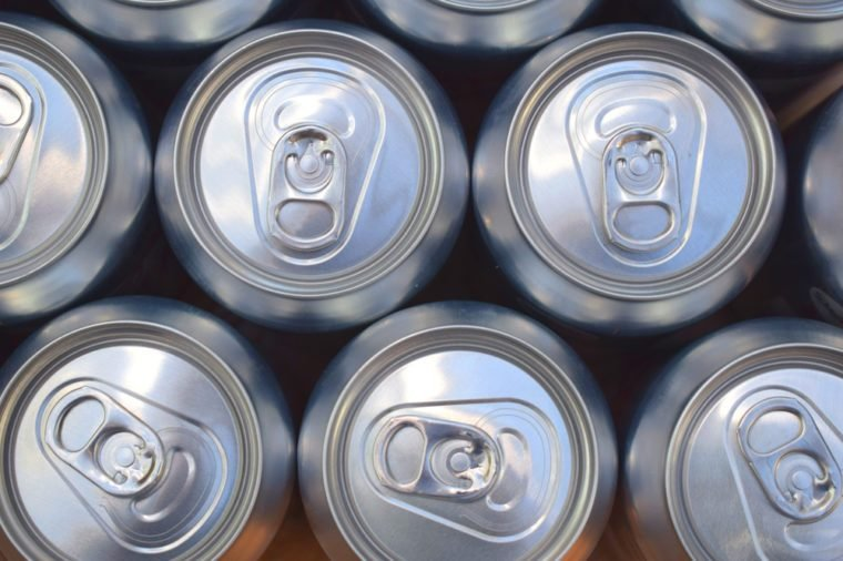 Aluminium Carbonated Drinks Cans Lined Up In Pattern And Photographed From Above